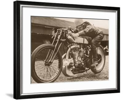 Man Sitting on Vintage Motorcycle--Framed Photographic Print
