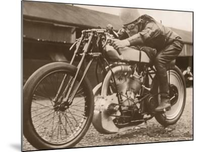 Man Sitting on Vintage Motorcycle--Mounted Photographic Print