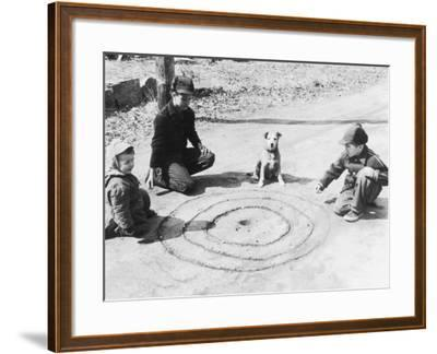 Boys Playing Marbles, Dog Watching--Framed Photographic Print