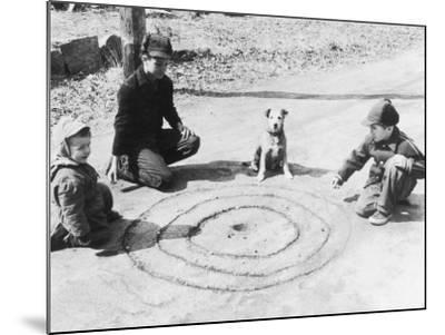 Boys Playing Marbles, Dog Watching--Mounted Photographic Print