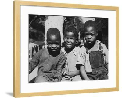 Boys and Girl Sitting--Framed Photographic Print