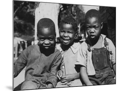 Boys and Girl Sitting--Mounted Photographic Print