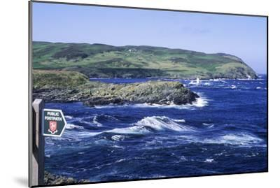 Manx Footpath Sign, Symbol, Overlooking Coast-Neil Holmes-Mounted Photographic Print