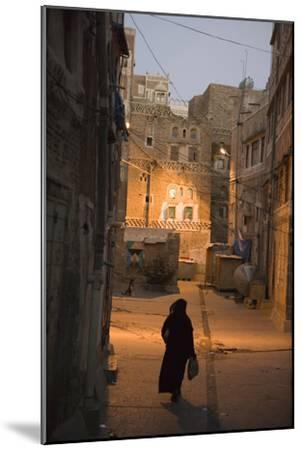 Woman Walking in Old Town, Dusk, San'a, Yemen, Middle East-Holger Leue-Mounted Photographic Print