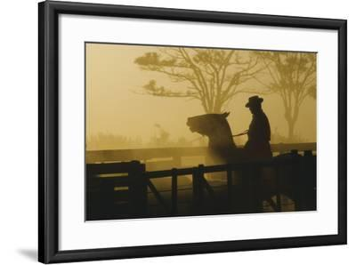 Silhouette of Man Riding Horse at Dusk-Nicolas Russell-Framed Photographic Print