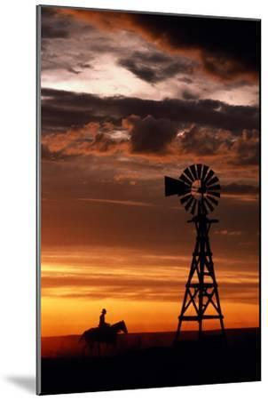 Man on Horse, Riding past Wind Turbine, Silhouetted at Sunset-Kathi Lamm-Mounted Photographic Print
