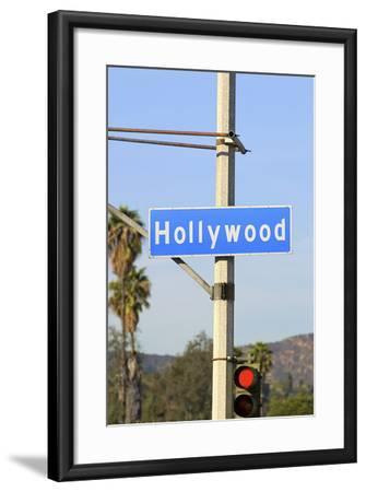 Close-Up of a Blue Street Sign on a Lamppost for Hollywood.-Thinkstock-Framed Photographic Print