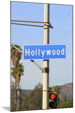 Close-Up of a Blue Street Sign on a Lamppost for Hollywood.-Thinkstock-Mounted Photographic Print