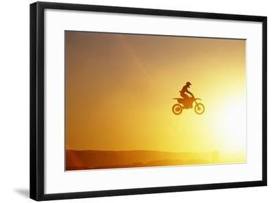 Silhouette of Motocross Race in mid Air, Sunset, Side View-John P Kelly-Framed Photographic Print