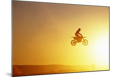Silhouette of Motocross Race in mid Air, Sunset, Side View-John P Kelly-Mounted Photographic Print