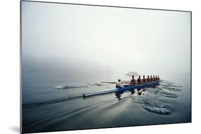 Rowing Team on Lake in Early Morning Fog-Nick Wilson-Mounted Photographic Print