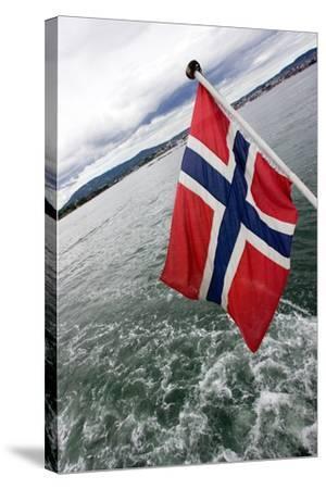 Norwegian Flag on a Boat-Felipe Rodríguez-Stretched Canvas Print