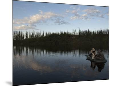 Two Undergraduate Students Use a Van Dorn Sampler to Collect Water Samples-Chris Linder-Mounted Photographic Print