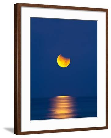 Partial Eclipse of the Moon, Setting over the Gulf of Mexico on the Morning of June 26, 2010-David Nunuk-Framed Photographic Print