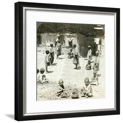 Children Playing Hopscotch, Kashmir, India, C1900s-Underwood & Underwood-Framed Photographic Print