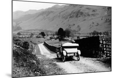 A Vintage Car Travelling Along a Lane Through the Lake District, Cumbria, 1920s--Mounted Photographic Print