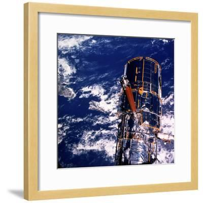 Hubble Space Telescope Above the Earth--Framed Photographic Print