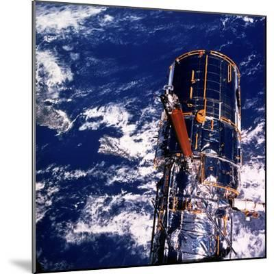 Hubble Space Telescope Above the Earth--Mounted Photographic Print