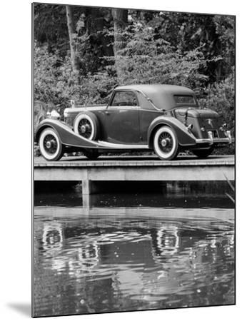 A 1933 Hispano-Suiza K6 Reflected in a Lake--Mounted Photographic Print