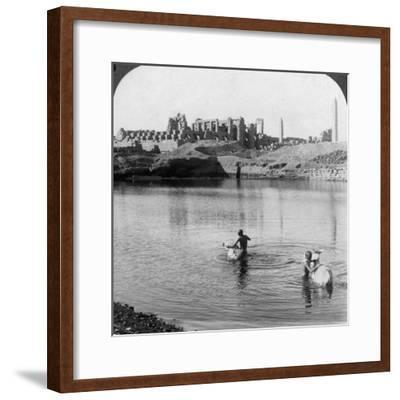 Looking across the Sacred Lake to the Great Temple at Karnak, Thebes, Egypt, 1905-Underwood & Underwood-Framed Photographic Print
