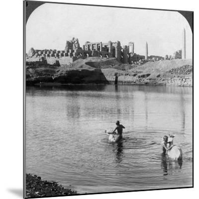 Looking across the Sacred Lake to the Great Temple at Karnak, Thebes, Egypt, 1905-Underwood & Underwood-Mounted Photographic Print
