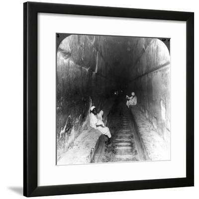 Looking Down the Main Passage to Khufu's Sepulchre Within the Great Pyramid, Egypt, 1905-Underwood & Underwood-Framed Photographic Print