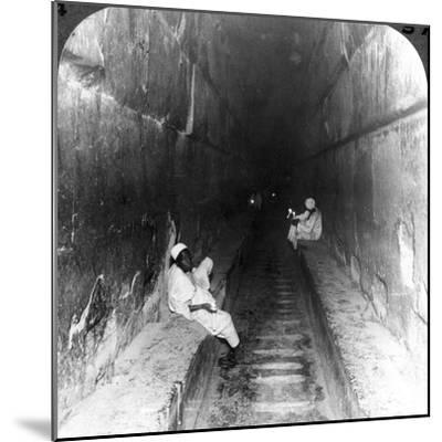 Looking Down the Main Passage to Khufu's Sepulchre Within the Great Pyramid, Egypt, 1905-Underwood & Underwood-Mounted Photographic Print