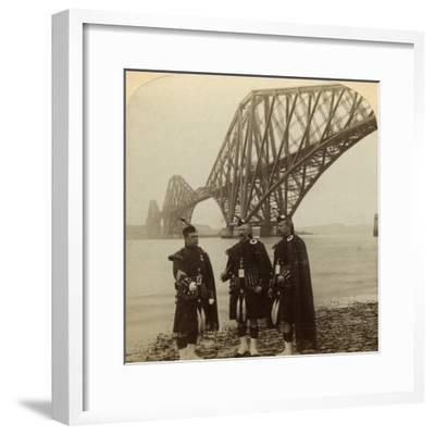 Men in Highland Dress in Front of the Forth Bridge, Scotland-Underwood & Underwood-Framed Photographic Print