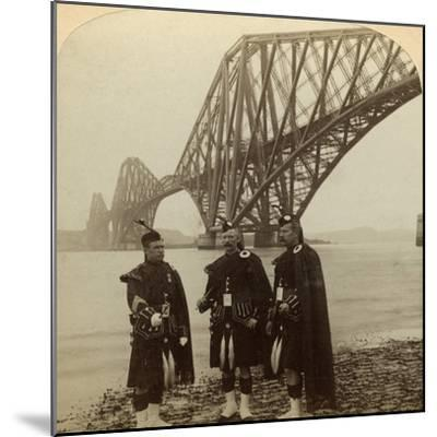 Men in Highland Dress in Front of the Forth Bridge, Scotland-Underwood & Underwood-Mounted Photographic Print