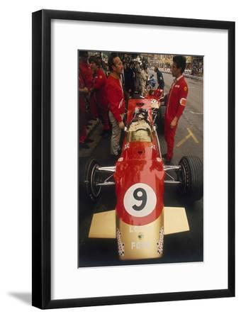Colin Chapman and a Mechanic in Discussion over Graham Hill's Lotus, Monaco Grand Prix, 1969--Framed Photographic Print