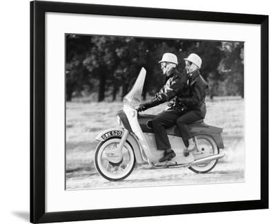 A Man and a Woman Riding an Ariel Leader, 1958--Framed Photographic Print