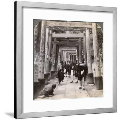 Coming and Going under Long Rows of Sacred Torii, Shinto Temple of Inari, Kyoto, Japan, 1904-Underwood & Underwood-Framed Photographic Print