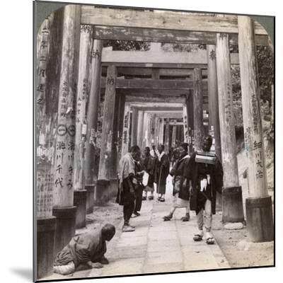 Coming and Going under Long Rows of Sacred Torii, Shinto Temple of Inari, Kyoto, Japan, 1904-Underwood & Underwood-Mounted Photographic Print