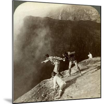 Gaving Through Sulphurous Vapors into the Crater's Depths, Aso-San, Japan, 1904-Underwood & Underwood-Mounted Photographic Print