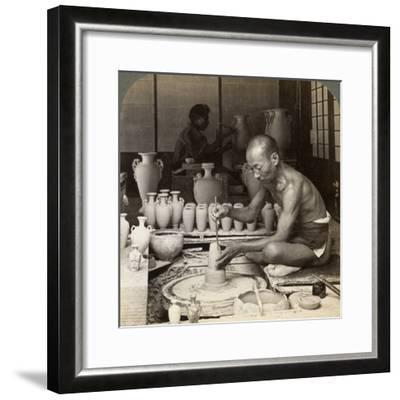 A Potter and His Wheel, Fashioning a Vase of Awata Porcelain, Kinkosan Works, Kyoto, Japan, 1904-Underwood & Underwood-Framed Photographic Print