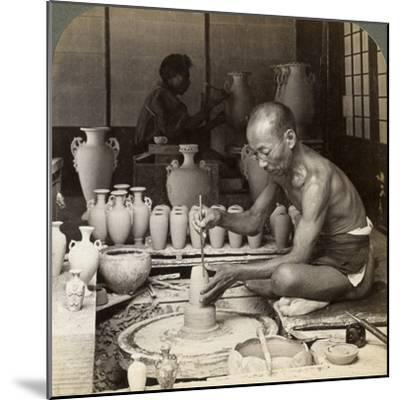 A Potter and His Wheel, Fashioning a Vase of Awata Porcelain, Kinkosan Works, Kyoto, Japan, 1904-Underwood & Underwood-Mounted Photographic Print