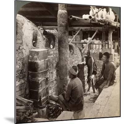 Workmen Watching Kilns Full of Awata Porcelain, Kinkosan Works, Kyoto, Japan, 1904-Underwood & Underwood-Mounted Photographic Print