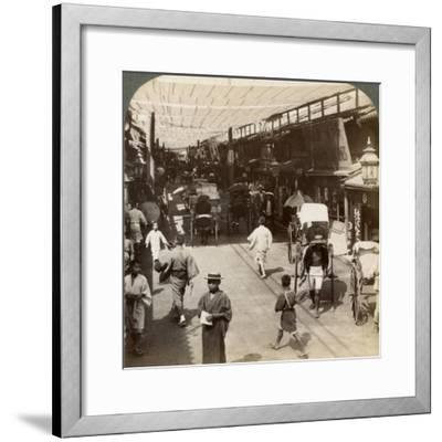Midsummer Traffic under the Awnings of Shijo Bashidori, a Busy Thoroughfare of Kyoto, Japan, 1904-Underwood & Underwood-Framed Photographic Print