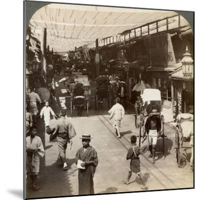 Midsummer Traffic under the Awnings of Shijo Bashidori, a Busy Thoroughfare of Kyoto, Japan, 1904-Underwood & Underwood-Mounted Photographic Print