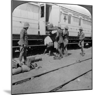 Lifting Wounded Soldiers onto a Hospital Train, East Africa, World War I, 1914-1918--Mounted Photographic Print