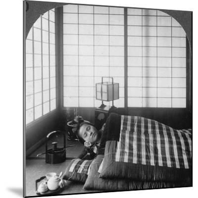 A Geisha Sleeping in a Tea House, Hikone, Japan, 1904-Underwood & Underwood-Mounted Photographic Print