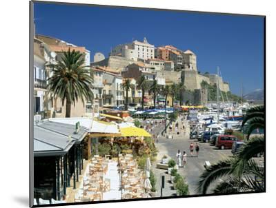 Restaurants in the Old Port with the Citadel in the Background, Calvi, Corsica-Peter Thompson-Mounted Photographic Print