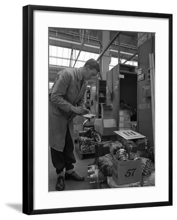 Warehouseman Checking Stock in the Stores at Bestwood Colliery, North Nottinghamshire, 1962-Michael Walters-Framed Photographic Print
