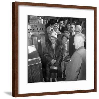 Women in Fur Coats at a Food Exhibition, Wilsic, Near Doncaster, South Yorkshire, 1961-Michael Walters-Framed Photographic Print