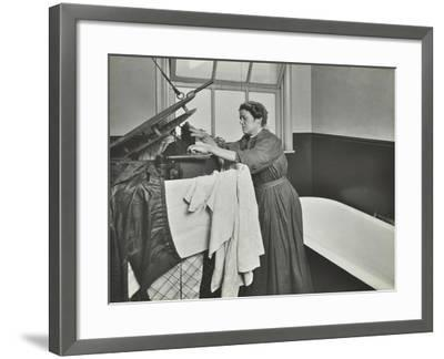 Nurse Using a Steriliser in the Bathroom at Chaucer Cleansing Station, London, 1911--Framed Photographic Print
