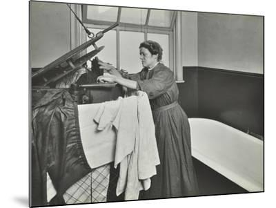 Nurse Using a Steriliser in the Bathroom at Chaucer Cleansing Station, London, 1911--Mounted Photographic Print
