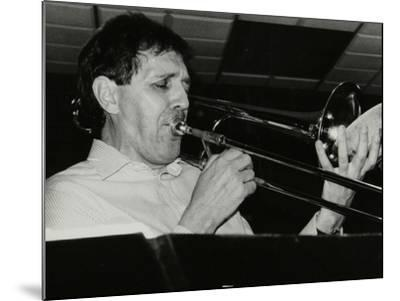 Trombonist Derek Wadsworth Playing at the Fairway, Welwyn Garden City, Hertfordshire, 28 July 1991-Denis Williams-Mounted Photographic Print