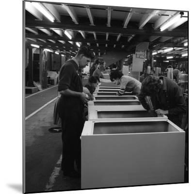 Fridge Assembly Line at the General Electric Company, Swinton, South Yorkshire, 1964-Michael Walters-Mounted Photographic Print