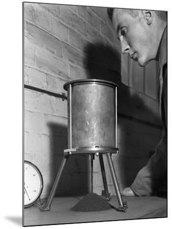A Lab Technician Undertaking a Coal Flow Test, Mapperley Colliery, Derbyshire, 1962-Michael Walters-Mounted Photographic Print