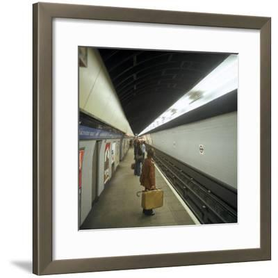Passengers Waiting at Blackhorse Tube Station on the Victoria Line, London, 1974-Michael Walters-Framed Photographic Print